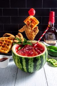red drink in a hollowed out watermelon