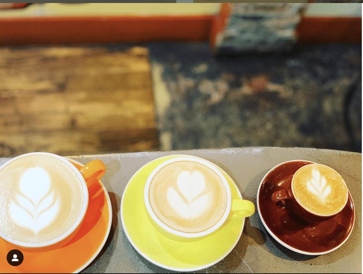 Three espresso cups with foam decorations