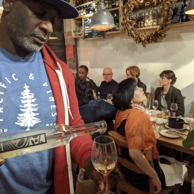 A man pouring wine at the Crick PDX