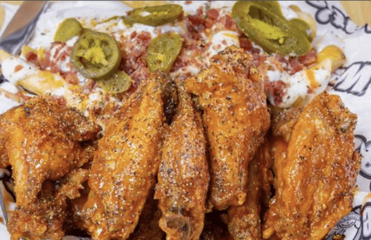 Chicken wings and loaded fries from We Dat's, a black owned franchise